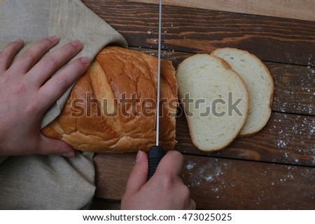 White bread with hands and cutting