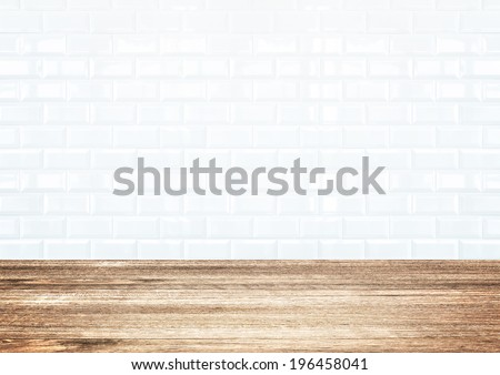 White brick tile wall and wood plank floor - stock photo