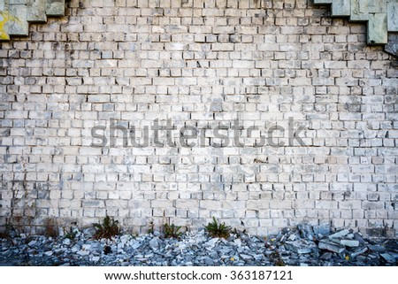 White brick wall and a side walk - stock photo
