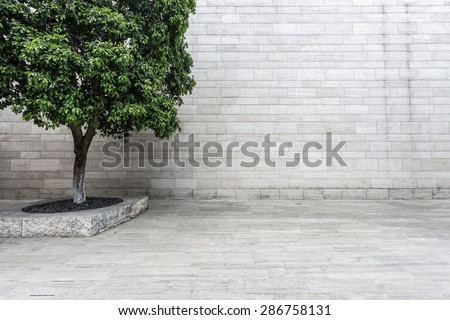 white brick wall and empty sandstone road - stock photo
