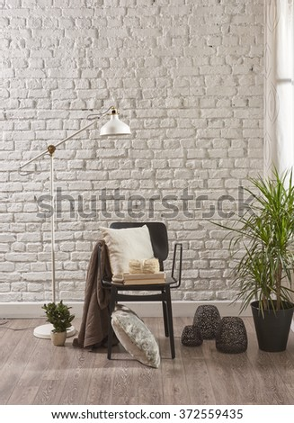 white brick wall and pillow black chair with curtain decor - stock photo