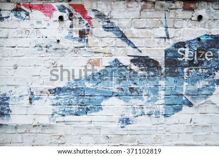 white brick wall and ripped street poster - stock photo