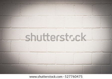 White brick wall background texture with vignetting.