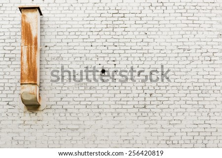 white brick wall, close up, with stucco - stock photo