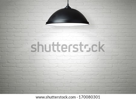 White brick wall illuminated by the ceiling lamp with copy space - stock photo
