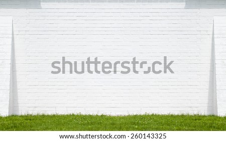 White brick wall made of bricks. Place for text, on a sunny day - stock photo