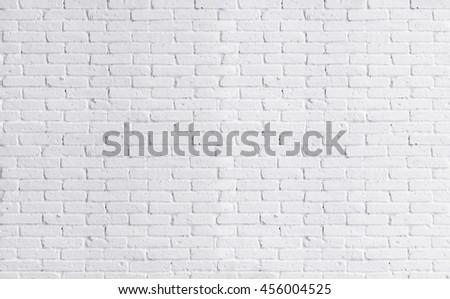 White brick wall, perfect as a background, Loft styled white brick wall. - stock photo