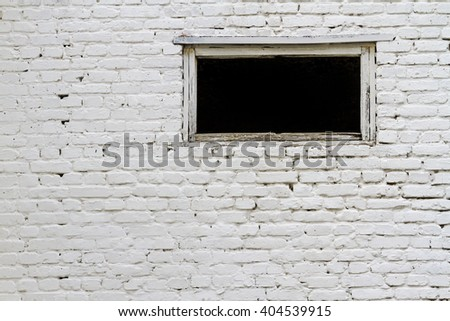 White brick wall with a window, building structures, abandoned building - stock photo