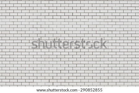 White brick wall with dark seams as background - stock photo