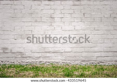 White brick wall with grass