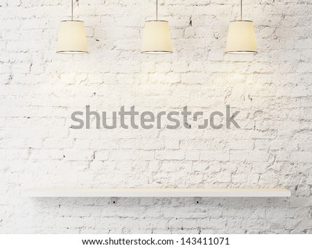 white brick wall with shelf and lamps - stock photo