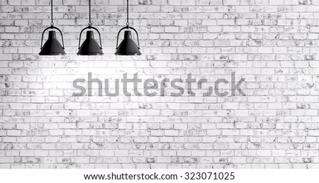 White brick wall with three lamps background - stock photo