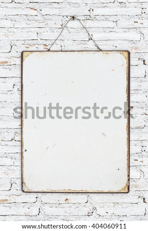 white brick wall with vintage poster - stock photo