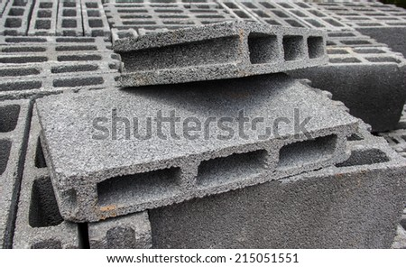 White bricks for building construction in front of the way - stock photo