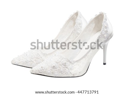 White bridal wedding shoes (footwear) isolated on white background. Clipping path inside. Handmade Lace decorates. - stock photo