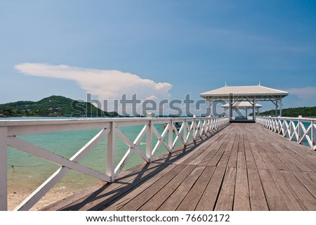 White bridge in to the sea  tilted to the right with beautiful blue sky - stock photo