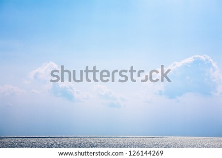 White bright fluffy clouds on a blue sky above the sea. Anapa, Russia - stock photo