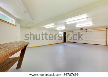 White bright new empty garage - stock photo