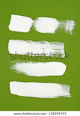 White brush strokes on bright green background. - stock photo