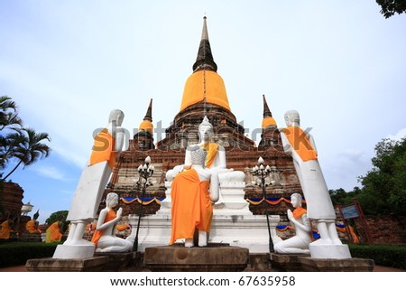 White Buddha images in front of ancient pagoda in Ayuthaya, Thailand - stock photo