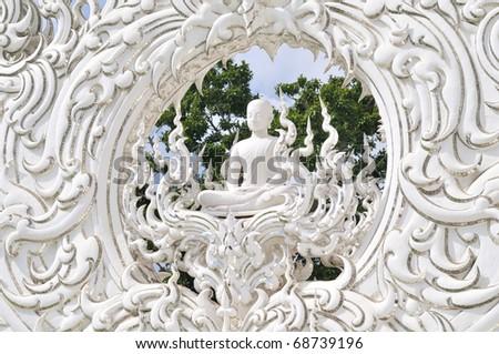 White Buddha in thai architecture - stock photo