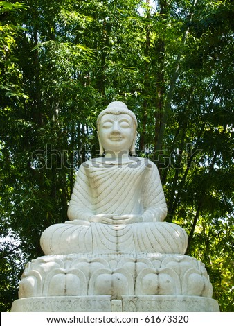 White Buddha statue in the bamboo forest - stock photo