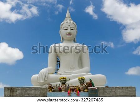 White Buddha  with sky blue background - stock photo