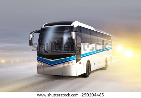 white bus moves on ice road in blizzard - stock photo