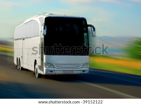 white bus on the road - stock photo