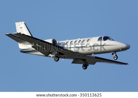 White business airplane approaching runway - stock photo