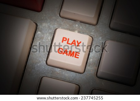 White button on a dirty old panel, selective focus - play game - stock photo