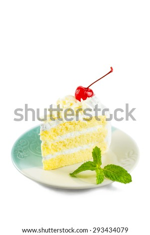 white cake delicious, vanilla cake topping with white chocolate chips decorated with whipped cream and cherries white mint on dish on white background. - stock photo