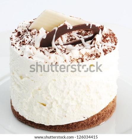 white cake on white dish - stock photo