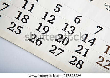 white calendar days with numbers close up