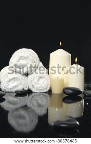 White candle and roller towel with reflection