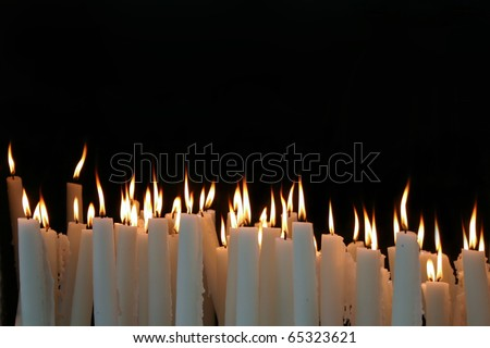 White Candle flames on a black background - stock photo