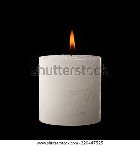 White candle lit on black. - stock photo