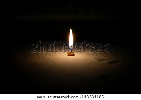 White candle on a black background