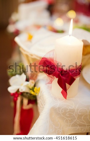 white candle with red bow - stock photo