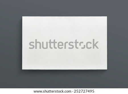 White canvas frame on gray background. - stock photo