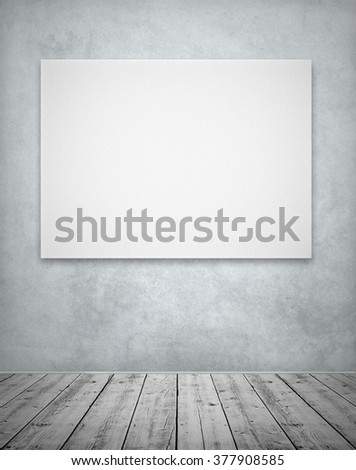 White canvas in room with textured wall and wooden floor - stock photo