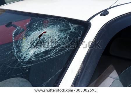 White car with smashed windshield - stock photo