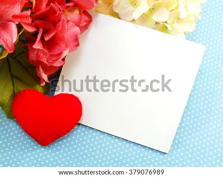 white card and red heart valentines day on blue polka dot background - stock photo