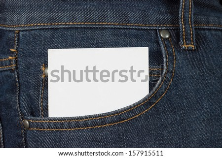 White card in a jeans pocket