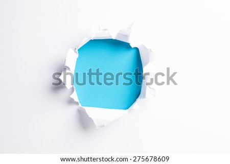 White card with hold punched through - colorful blue background