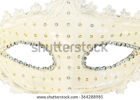 White carnival mask decorations isolated background front view close-up - stock photo