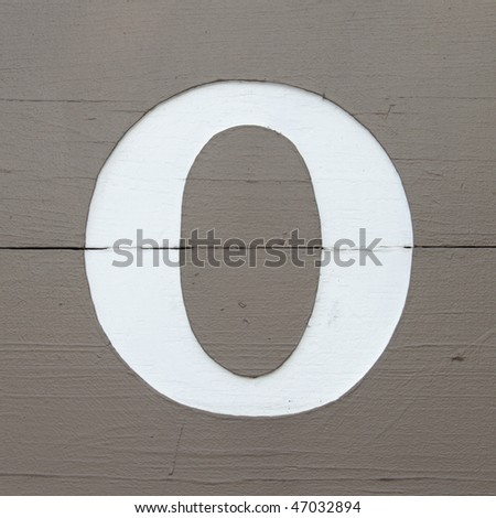 White carved letter o on the wooden board - stock photo