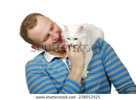 white cat sits on a shoulder at the young man - stock photo