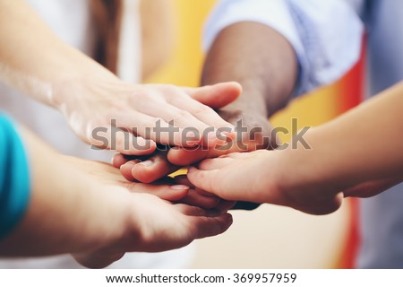 White caucasian and black afro american hands holding together, friendship concept - stock photo