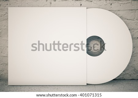 White CD disk on concrete background. 3D Rendering - stock photo